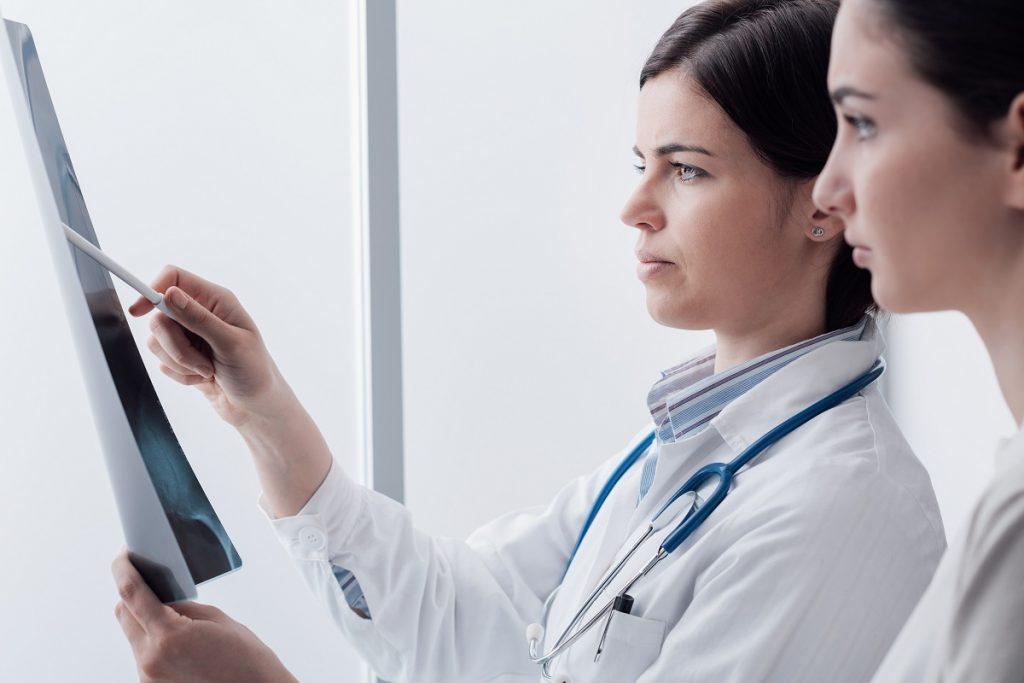 doctors looking at xray