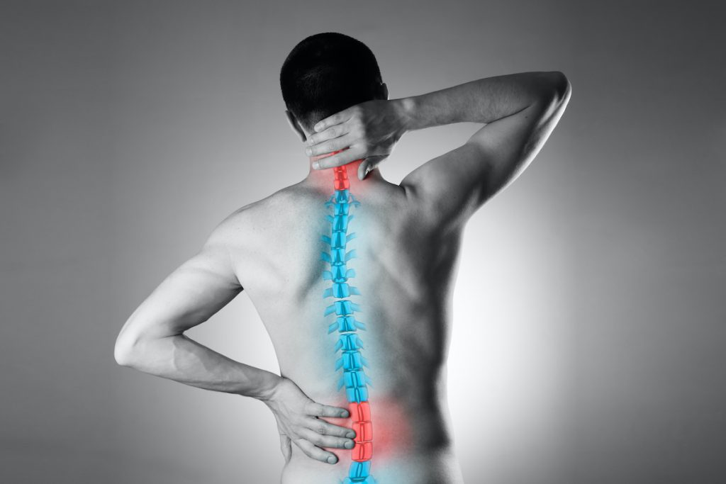 man experiencing neck and lower back pain