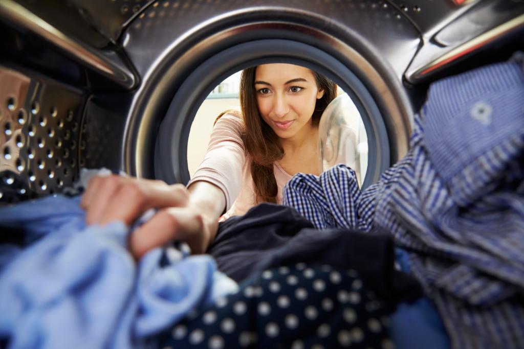 Reaching Inside Washing Machine